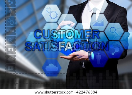 "Glowing text ""Customer Satisfaction"" in the hands of a businessman. Business concept. Internet concept."