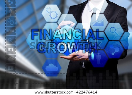 """Glowing text """"Financial Growth"""" in the hands of a businessman. Business concept. Internet concept. - stock photo"""