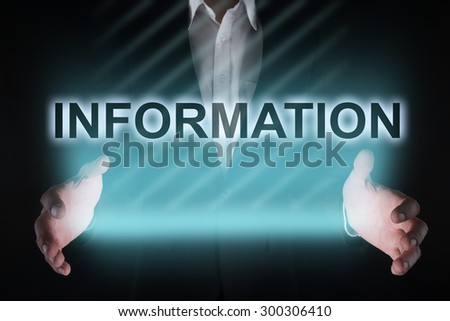 "Glowing text ""information"" in the hands of a businessman. Business concept.  - stock photo"