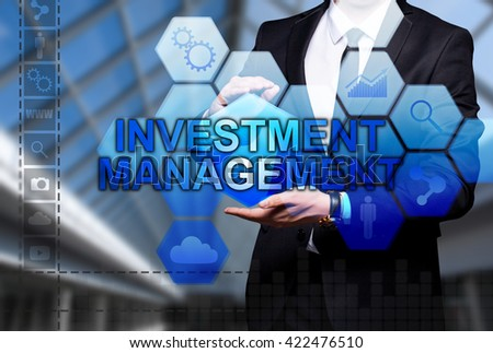 "Glowing text ""Investment Management"" in the hands of a businessman. Business concept. Internet concept."