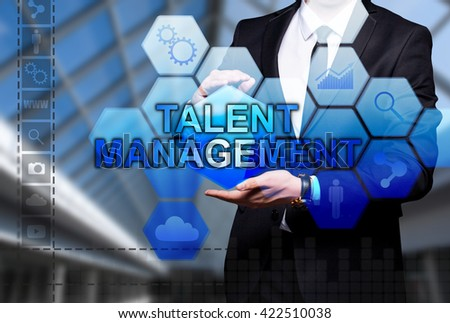 "Glowing text ""Talent Management"" in the hands of a businessman. Business concept. Internet concept."