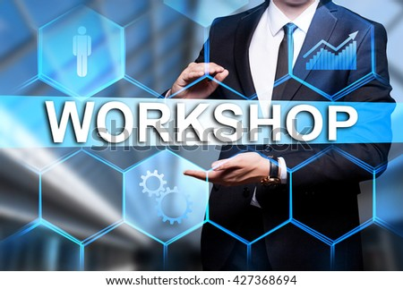 "Glowing text ""Workshop"" in the hands of a businessman. Business concept. Internet concept. - stock photo"