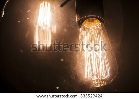 glowing tungsten lamp - stock photo
