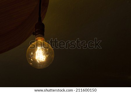 glowing tungsten light bulb - stock photo