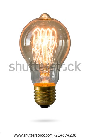 Glowing yellow light bulb isolated on white background - stock photo