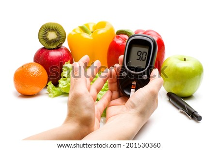 glucometer for glucose level and healthy organic food on a white background. Diabetes concept - stock photo