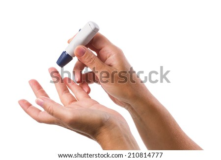 Glucometer in woman's hand for measuring glucose level blood test isolated on a white background