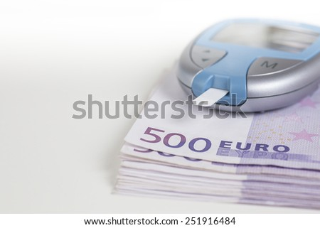 Glucometer on 500 Euro notes - stock photo