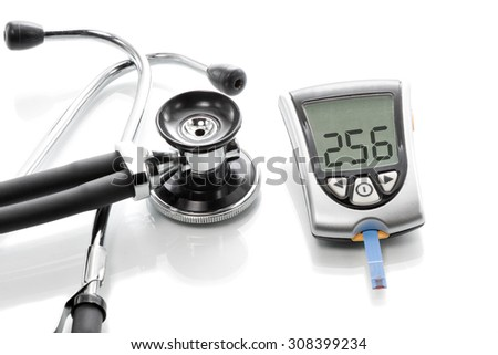 Glucose concentration in the blood test with a blood glucose meter - stock photo