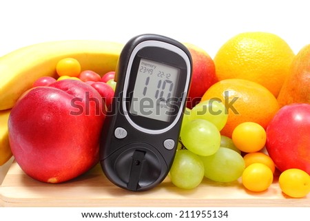 Glucose meter and fresh ripe fruits lying on wooden cutting board, concept for healthy eating and diabetes. Isolated on white background - stock photo