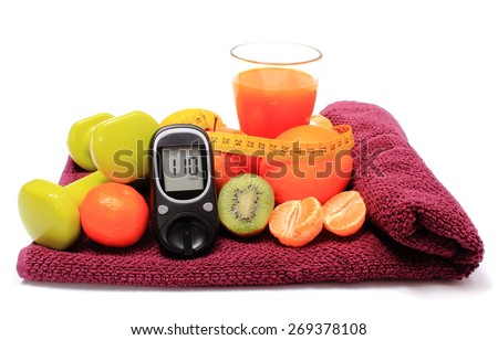 Glucose meter, fresh fruits with tape measure, glass of juice and green dumbbells for fitness, concept for diabetes, slimming, healthy nutrition and strengthening immunity - stock photo
