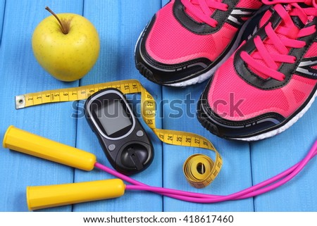 Glucose meter, sport shoes, apple and accessories for fitness or sport, diabetes, healthy and active lifestyles - stock photo