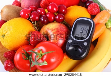 Glucose meter with fresh ripe fruits and vegetables, concept of diabetes, healthy food, nutrition and strengthening immunity. Isolated on white background - stock photo