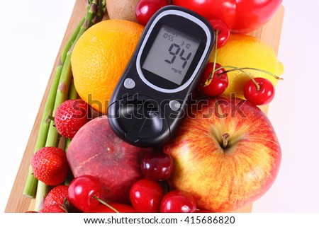 Glucose meter with fresh ripe fruits and vegetables, concept of diabetes, healthy food, nutrition and strengthening immunity. White background