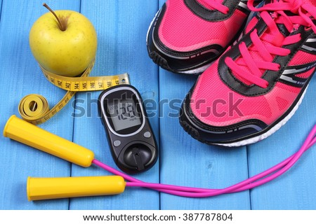 Glucose meter with result of sugar level, sport shoes, apple and accessories for fitness or sport, diabetes, healthy and active lifestyles - stock photo