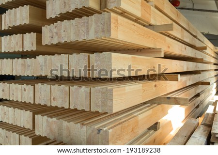 Glued pine timber beams in a production manufactory  - stock photo