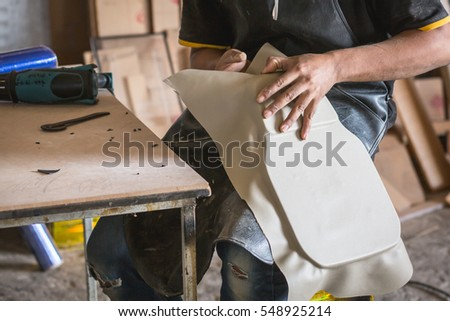 gluing leather in a workshop