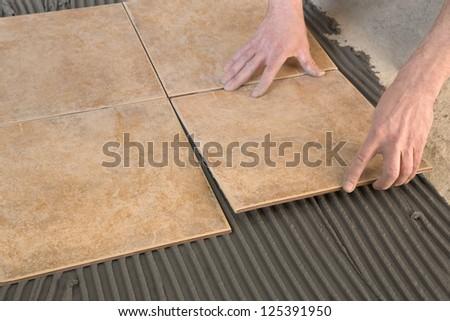 gluing tiles - stock photo