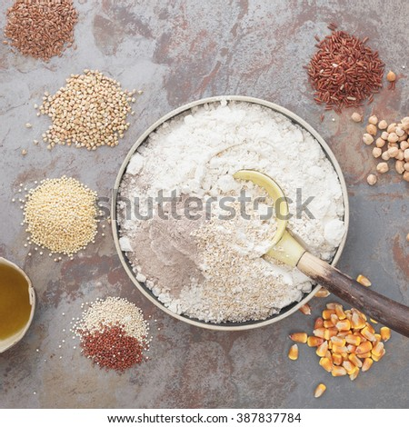 Gluten Free Baking. Overhead view of bowl with flour and grains next to bowl  on table - stock photo