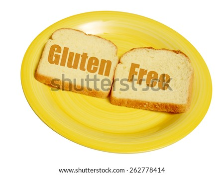 Gluten free bread on a yellow plate - stock photo