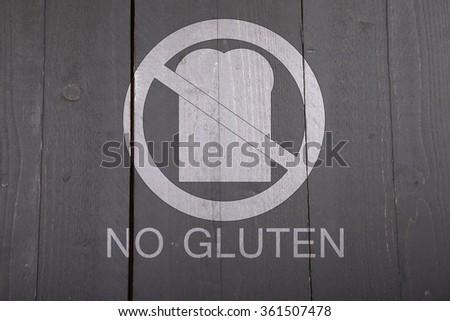 Gluten free bread sign on black wooden background - stock photo