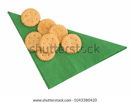 Gluten free cracker biscuits on green paper serviette.
