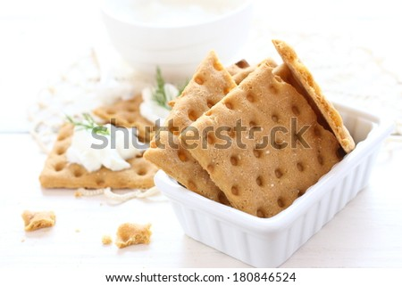 Gluten free crispbread with cream cheese and dill - stock photo