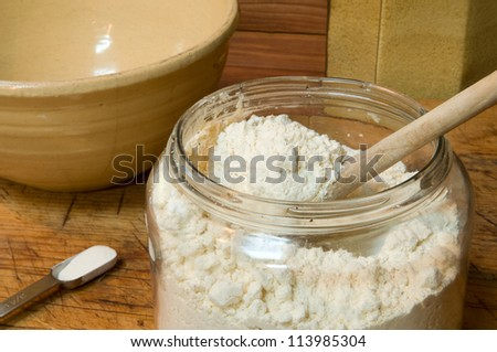 Gluten-free flour for baking, in an old jar with spoon: contains garbanzo bean, potato, tapioca, sorghum, and fava bean flours.  Also, 3/4 teaspoon xanthan gum - important for gluten-free baking.