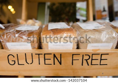 Gluten Free loaf of breads on display in a health food shop. Concept photo of healthy food lifestyle. - stock photo