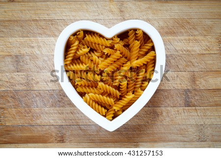 Gluten free pasta in heart shape bowl