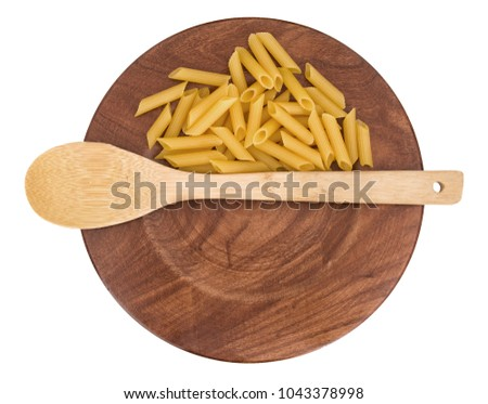 Gluten free pasta with copy space on wooden plate.