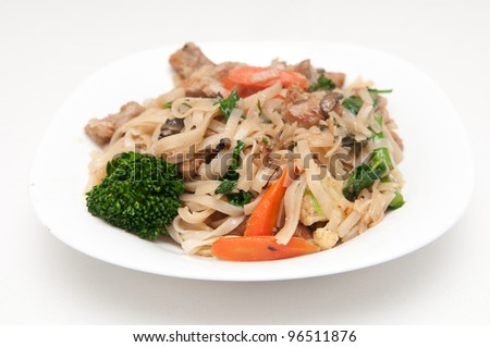 gluten free rice noodles with fresh stir fried vegetables and diced pork tenderloin