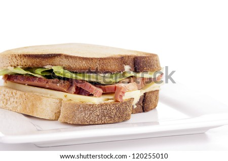 Gluten free sandwich with home-made bread, cheese, roast beef and lettuce