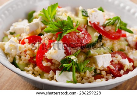 Gluten free vegetarian salad  with a feta. Selective focus - stock photo