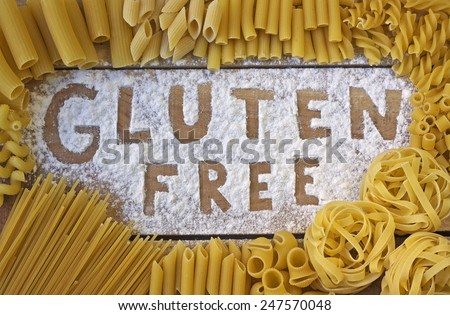 gluten free word with wood background - stock photo