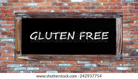 Gluten free words on chalk board background - stock photo