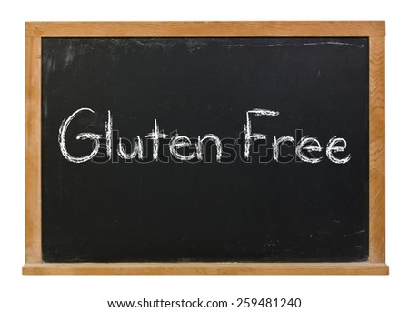 Gluten free written in white chalk on a black chalkboard isolated on white - stock photo