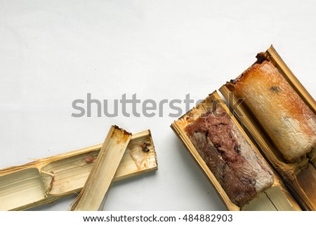 Glutinous rice roasted in bamboo two-piece white background.