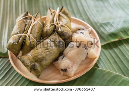 Glutinous rice steamed in banana leaf ( Khao Tom Mat or Khao Tom Pad ), Thailand.