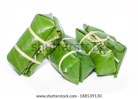 Glutinous rice steamed in banana leaf ( Khao Tom Mat ) Thai dessert