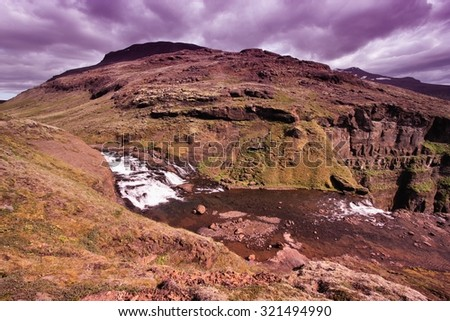 Glymur - tallest waterfall in Iceland. Beautiful mountain river canyon. Filtered color tone.