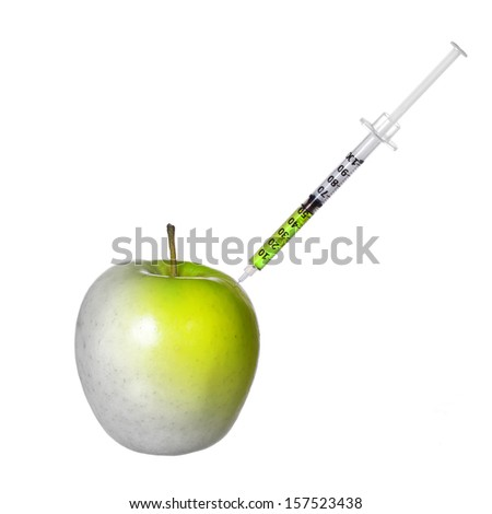 GMO food concept. Genetically modified green apple and syringe isolated on white background. Genetic injection  - stock photo
