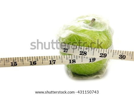 GMO fruit, Green Apple wrapped with plastic. Concept for genetically modified foods or altered using genetic engineering techniques.