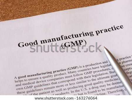 GMP - good manufacturing practice used for production and testing quality product - stock photo