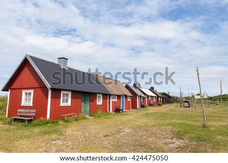 GNISVAERD, GOTLAND, SWEDEN, JULY 2014, traditional red fishing huts on a sunny summer day.