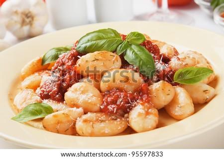 Gnocchi di patata, italian potato noodle with tomato sauce and basil - stock photo