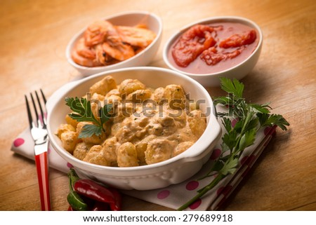 gnocchi with shrimp sauce and tomatoes,  selective focus - stock photo