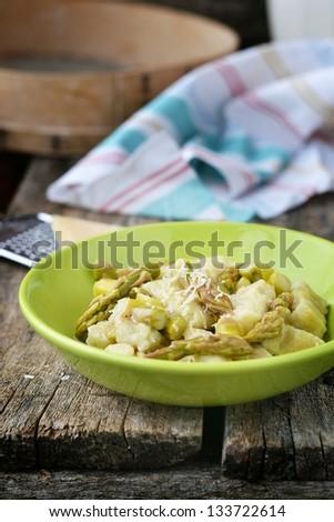 gnocci with asparagus. - stock photo