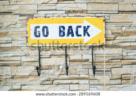 Go back sign on the wall
