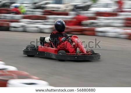Go cart racer struggling on circuit - stock photo